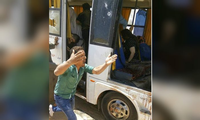 A man screams beside a bus carrying Coptic Christians which came under attack outside Cairo, on Nov. 2, 2018. (Egypt's Coptic Orthodox Church via AP)