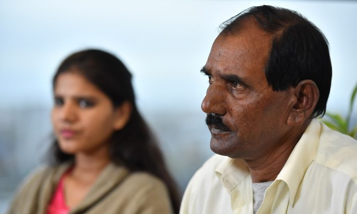 Ashiq Mesih (R) and Eisham Ashiq, the husband and daughter of Asia Bibi, speak during an interview with AFP in London, on Oct. 12, 2018. (Ben Stansall/AFP/Getty Images)