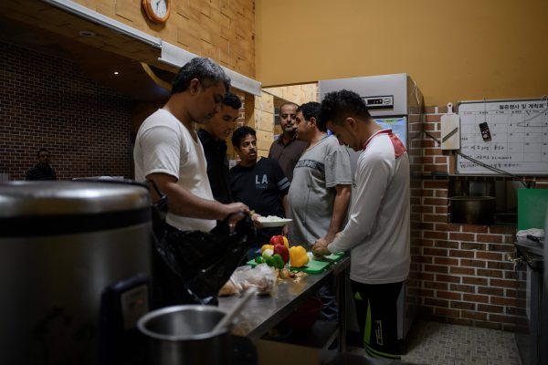 Yemeni asylum-seekers prepare lunch at the Olle Tourist Hotel in Jeju, South Korea.