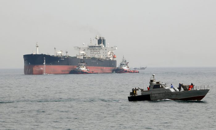 An Iranian military speedboat patrols the waters as a tanker prepares to dock at the oil facility in Iran's Kharg Island, on the shore of the Persian Gulf, on March 12, 2017.  (ATTA KENARE/AFP/Getty Images)