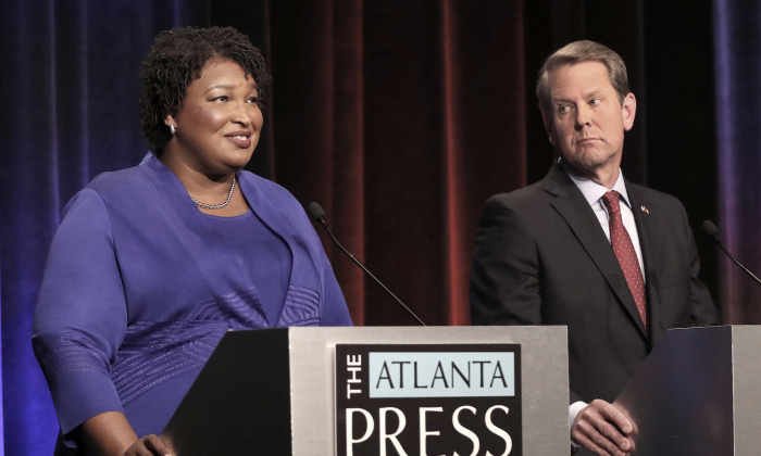 Georgia gubernatorial candidates (L-R) Democrat Stacey Abrams and Republican Brian Kemp debate in an event that also included Libertarian Ted Metz at Georgia Public Broadcasting in Midtown in Atlanta, Georgia Oct. 23, 2018. (John Bazemore-Pool/Getty Images)