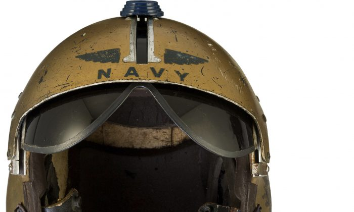 A helmet worn by John Glenn during the history-making flight, dubbed Project Bullet, in which the future astronaut set the transcontinental speed record in 1957. Artifacts owned by the late Neil Armstrong will be offered for sale by Dallas-based Heritage Auctions starting Thursday, Nov. 1, 2018, including pieces of a wing and propeller from the 1903 Wright Flyer the astronaut took with him to the moon in 1969.  (Heritage Auctions/AP)