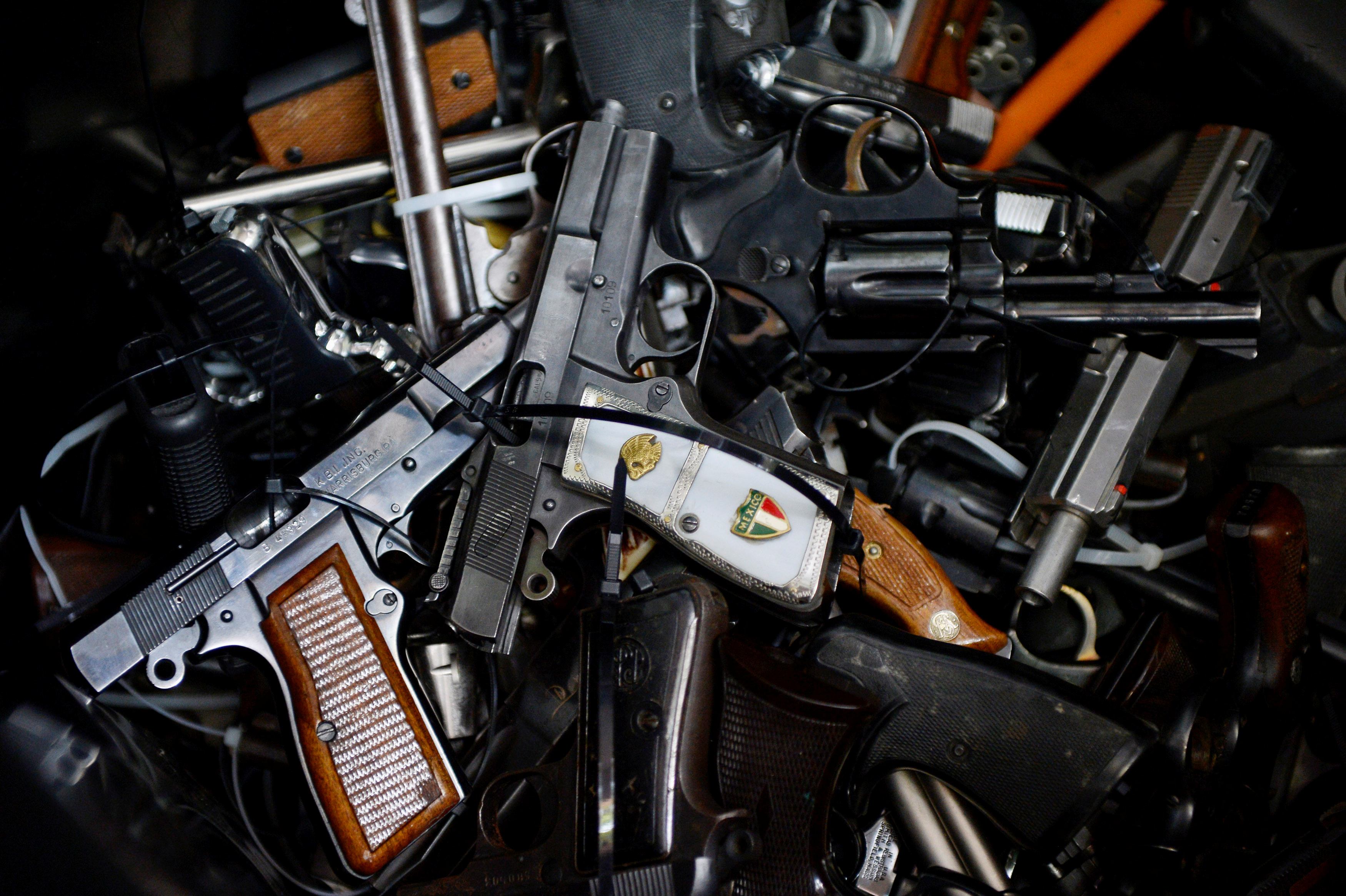 Surrendered handguns are seen during a gun buyback event in Los Angeles