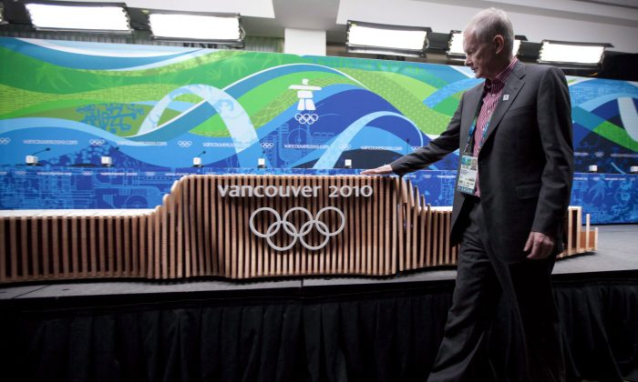 Chief Executive Officer John Furlong checks out the victory ceremony podium for the Vancouver 2010 Winter Olympic Games during an unveiling news conference in Vancouver on February 2, 2010. (Jonathan Hayward/The Canadian Press)