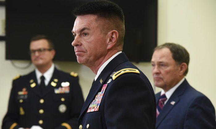 Maj. Gen. Jefferson S. Burton, center, address the media in Draper, Utah. on Nov. 4, 2018. (Francisco Kjolseth/The Salt Lake Tribune, via AP)