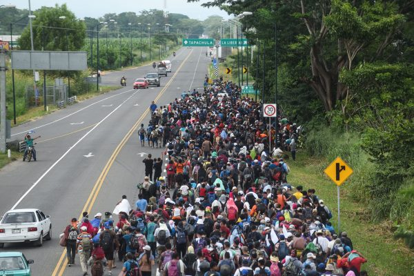 Migrants in a caravan heading to the United States walk alongside the route between Ciudad Hidalgo and Tapachula in Mexico.