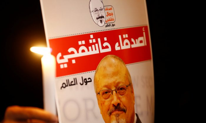 A demonstrator holds a poster with a picture of Saudi journalist Jamal Khashoggi outside the Saudi Arabia consulate in Istanbul, Turkey, on Oct. 25, 2018. (Osman Orsal/Reuters)