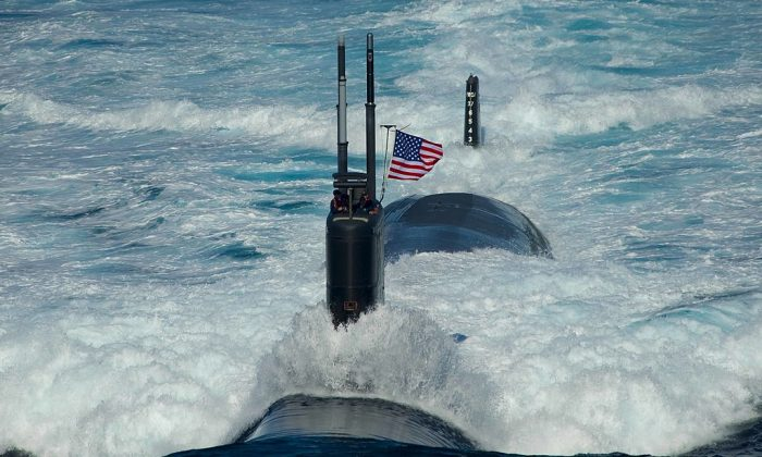 In this handout image provided by the U.S. Navy, the Los Angeles-class attack submarine USS Tuscon (SSN 770) transits the East Sea, Jul. 26, 2010 while leading a 13-ship formation. (Mass Communication Specialist 3rd Class Adam K. Thomas/U.S. Navy via Getty Images)