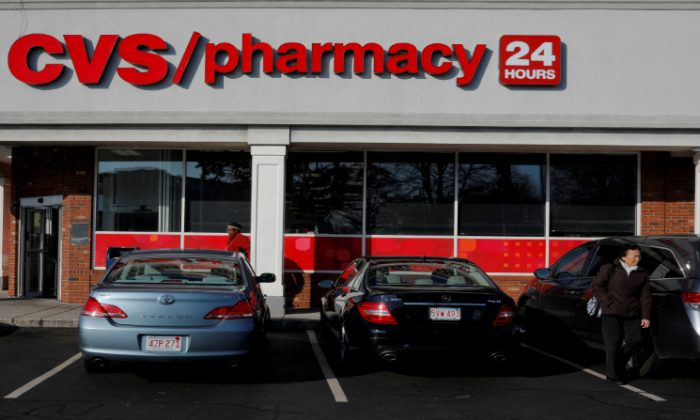 Shoppers walk outside a CVS store and pharmacy in Medford, Massachusetts, U.S. December 4, 2017. (Brian Snyder/File Photo/Reuters)