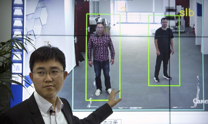 "Huang Yongzhen, CEO of Watrix, demonstrates the use of his firm's gait recognition software at his company's offices in Beijing on Oct. 31, 2018. A Chinese technology startup hopes to begin selling software that recognizes people by their body shape and how they walk, enabling identification when faces are hidden from cameras. Already used by police on the streets of Beijing and Shanghai, ""gait recognition"" is part of a major push to develop artificial-intelligence and data-driven surveillance across China, raising concern about how far the technology will go. (Mark Schiefelbein/AP)"