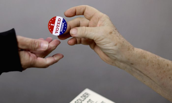 Voters get an 'I VOTED TODAY' sticker after casting their ballots on election day in Red Oak, Iowa on November 4, 2014. (Chip Somodevilla/Getty Images)