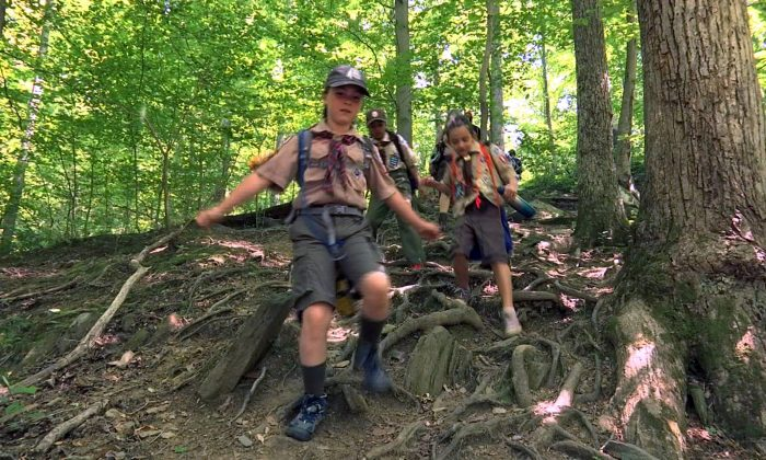 "Girls from Cub Scout Den 13, a suburban Virginia Cub Scout unit made up of girls who are on their way to next year becoming the first female Scouts in the Boy Scouts of America as part of the the newly named ""Scouts BSA"" program, participate in a hike in this still image from video shot in McLean, Virginia, on May 20, 2018. (Greg Savoy/File Photo/Reuters)"