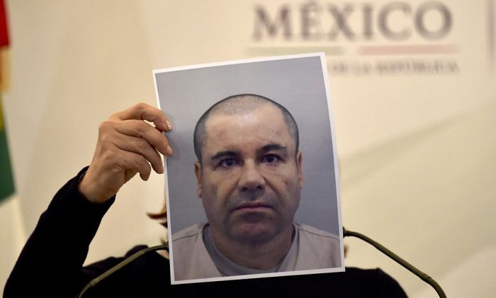 "Mexico's Attorney General Arely Gomez shows a picture of Mexican drug kingpin Joaquin ""El Chapo"" Guzman during a press conference held at the Secretaria de Gobernacion in Mexico City, on Jul. 13, 2015. (Yuri Cortez/AFP/Getty Images)"