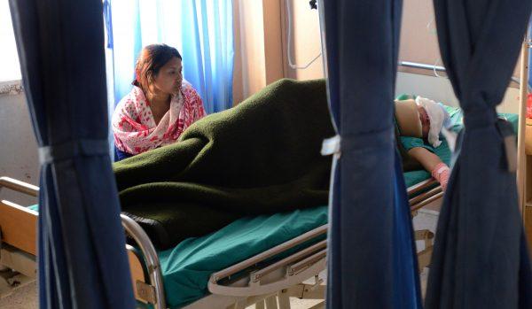 File photo of Sangita Magar resting on a hospital bed in Kathmandu, Nepal.
