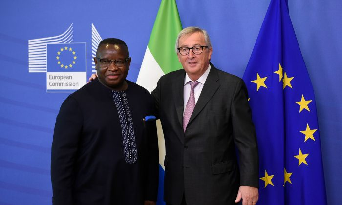 EU Commission President Jean Claude Juncker (R) welcomes President of Sierra Leone Julius Maada Bio before to their meeting at the EU headquarters in Brussels on Nov. 6, 2018. (John Thys/AFP/Getty Images)