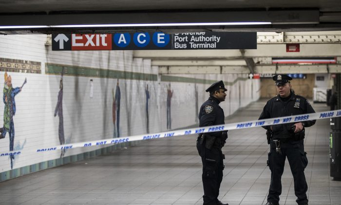 Police stand in a closed-off underground walkway near the site of a pipe bomb explosion in the tunnel that connects the Times Square subway station to the Port Authority Bus Terminal, on Dec. 11, 2017. (City.gerer/Getty Images)