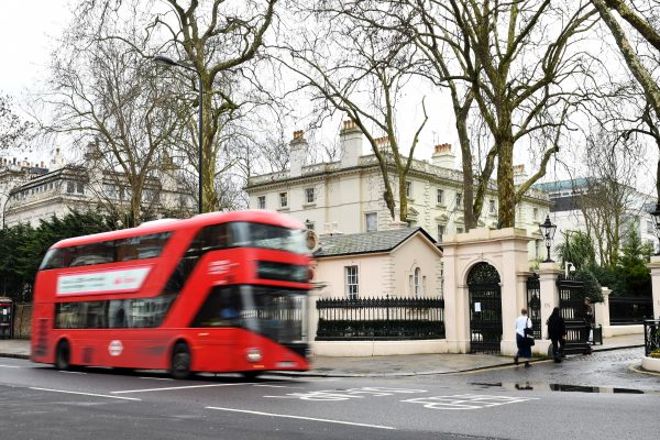 A London bus drives past a private road in front of the Russian Embassy