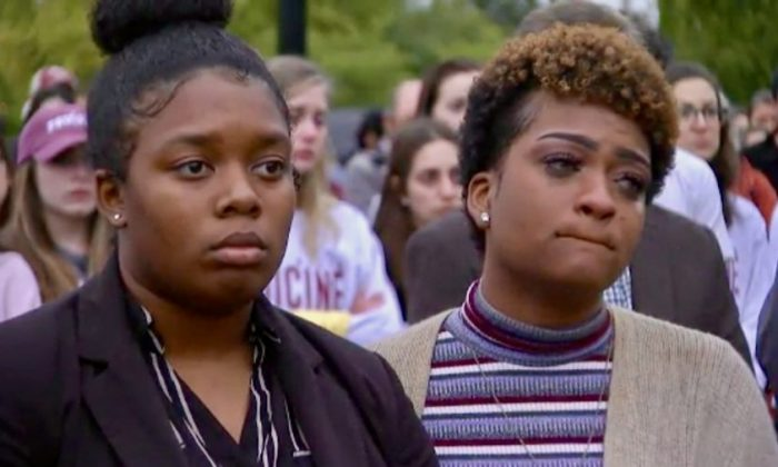 Community gathers for yoga studio shooting victims in Tallahassee, Florida, on Nov. 4. (Screenshot via CNN)