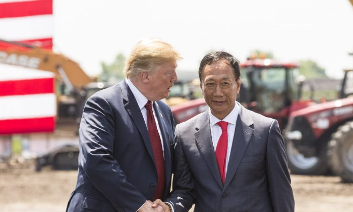 President Donald Trump (L) shakes hands with Foxconn Chairman Terry Gou at the groundbreaking for the Foxconn Technology Group computer screen plant in Mt Pleasant, Wisconsin, on June 28, 2018. (Andy Manis/Getty Images)