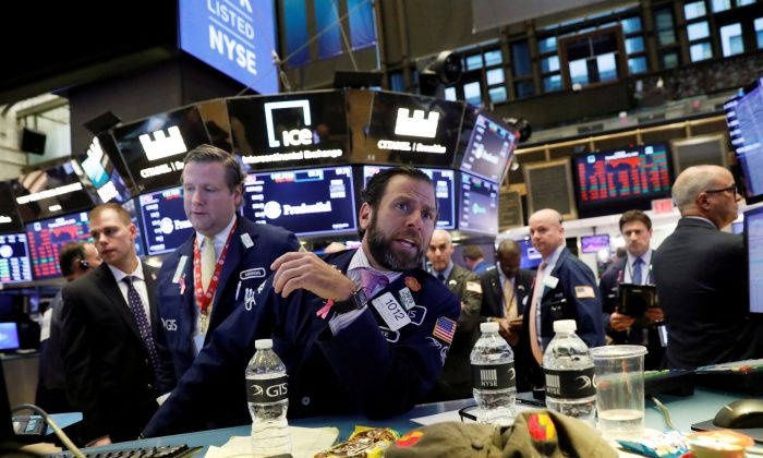 File photo of traders working on the floor of the New York Stock Exchange (NYSE) in New York, U.S., Oct. 11, 2018. (Reuters/Brendan McDermid/File Photo)