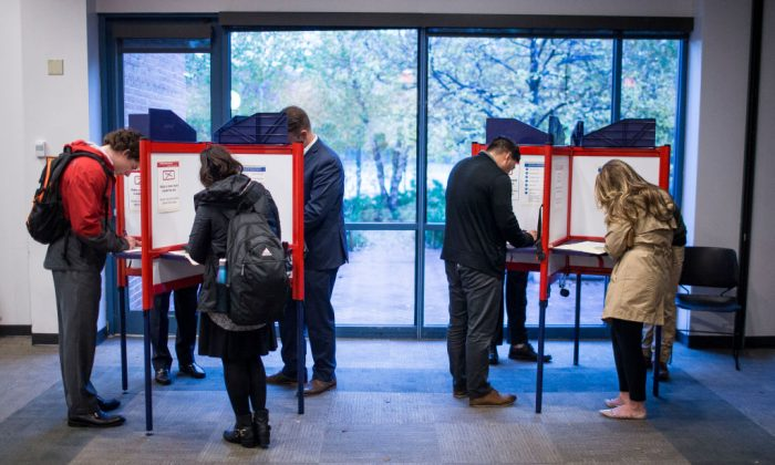 Voters cast ballots at the Arlington Central Library during the 2018 mid-term election on Nov. 6, 2018 in Arlington, VA. (Zach Gibson/Getty Images)