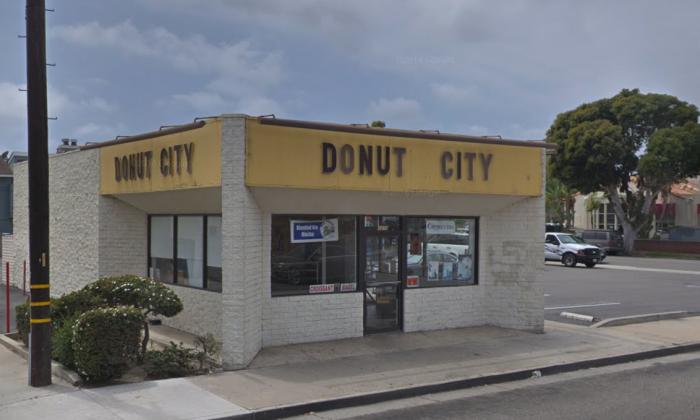 John Chhan and his wife Stella own the doughnut shop Donut City in Seal Beach, Calif. (Screenshot/Google Maps)