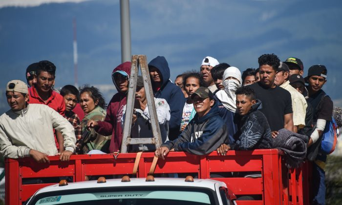 Migrants from Central American countries -mostly Hondurans- heading in a caravan to the U.S., on board a truck at the Mexico City-Puebla highway in San Marcos' toll, Mexico, on Nov. 5, 2018. (Rodrigo Arangua/AFP/Getty Images)