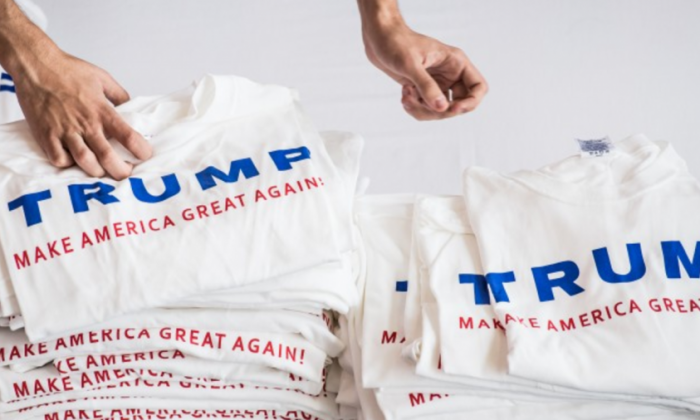 Volunteers pass out Donald Trump T-shirts at a campaign event Sept 23, 2015 in Columbia, South Carolina. (Sean Rayford/Getty Images)