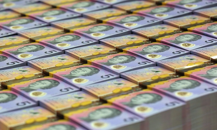 In this undated handout photo from the Reserve Bank of Australia (RBA) released on April 12, 2016 stacks of new style five Australian dollar note are seen, which will replace its more bland pink, purple and orange predecessor from September 1, 2016.(STR/AFP/Getty Images)