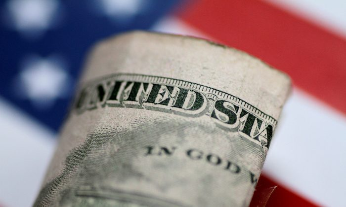 A U.S. five dollar note is seen in this illustration photo June 1, 2017.     (Reuters/Thomas White)