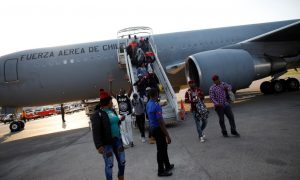 President of Chile Flies 176 Haitian Immigrants Home