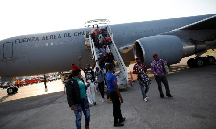 Haitians disembark from a Chilean Air Force plane as they return from Chile, upon their arrival to the International Airport of Port-au-Prince, Haiti, Nov. 7, 2018. (Reuters/Andres Martinez Casares)