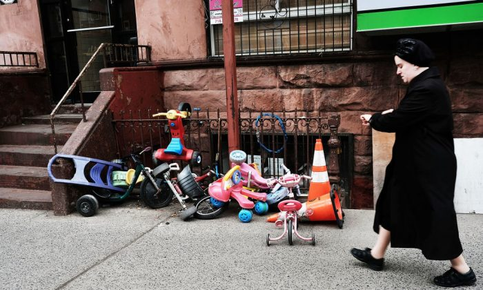 A Hasidic woman walks through a Jewish Orthodox neighborhood in Brooklyn, N.Y. on Apr. 24, 2017. (Spencer Platt/Getty Images)