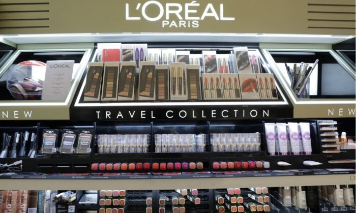 A cosmetic display of French cosmetics group L'Oreal is seen at a duty free shop at the Nice International Airport, in Nice, France, Oct. 10, 2018. (Reuters/Eric Gaillard)