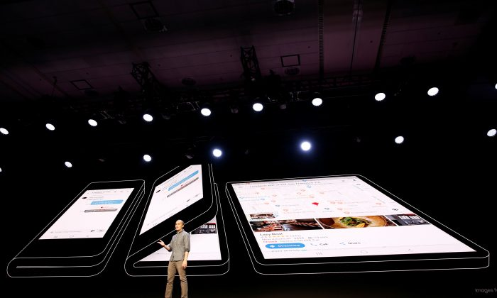 "Glen Murphy, Head of Android UX at Google, speaks during the unveiling of Samsung's new ""Infinity Flex"" foldable display, during the Samsung Developers Conference in San Francisco, California, on Nov. 7, 2018. (Stephen Lam/Reuters)"