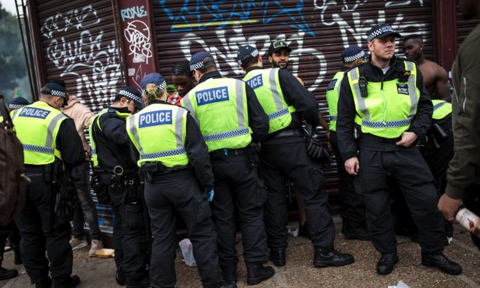 Police officers stop and search people on the final day of the Notting Hill Carnival in London on Aug. 27, 2018. (Jack Taylor/Getty Images)