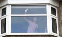 UK Police Posts Photo of Woman Cleaning Windows as a Warning