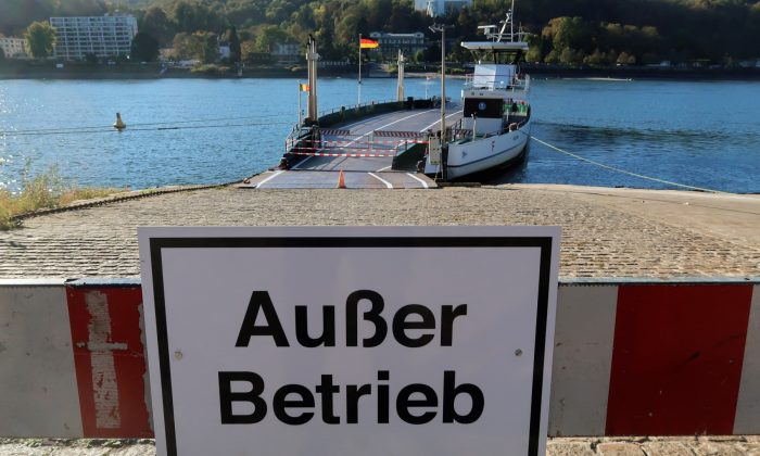 """A sign to the Rhine car ferry of Bad Honnef-Rolandseck reads """"out of order"""", in Bad Honnef, south of Bonn, Germany, on Oct. 21, 2018. (Wolfgang Rattay/Reuters)"""