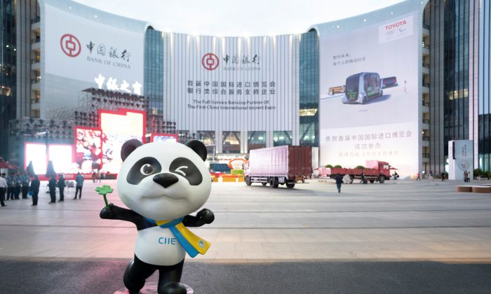 A statue of the China International Import Expo (CIIE)'s mascot is placed in front of a building hanging advertisement of Bank of China, at the venue for the expo in Shanghai, China on Nov. 2, 2018. (Reuters)