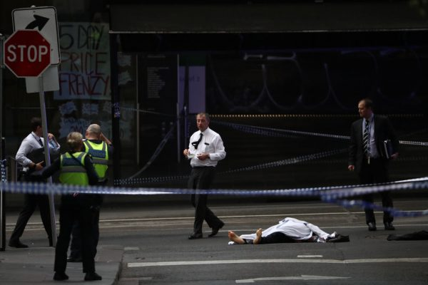 the body of a victim lies on the ground