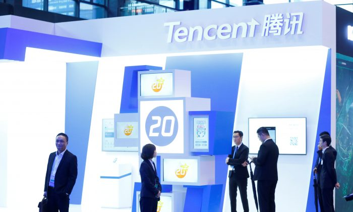 Tencent Holdings Chairman and CEO Pony Ma (C) visits the Tencent booth following the opening ceremony of the fifth World Internet Conference (WIC) in Wuzhen, Zhejiang Province, China on Nov. 7, 2018. (Reuters)