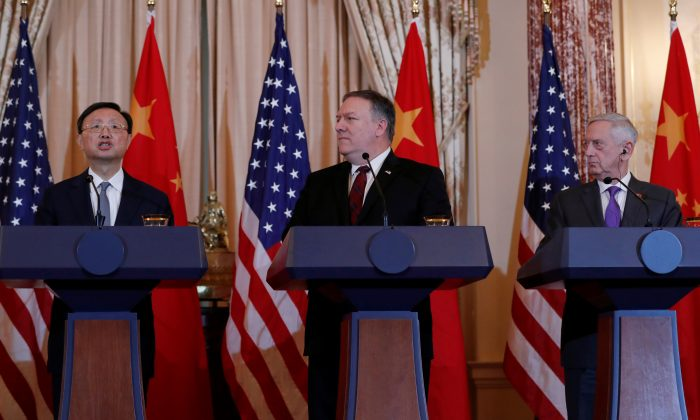 U.S. Secretary of State Mike Pompeo and Defense Secretary James Mattis listen to Chinese Communist Party Office of Foreign Affairs Director Yang Jiechi speak as they hold a joint media news conference after participating in a second diplomatic and security meeting at the U.S. Department of State, Washington, D.C. on Nov. 9, 2018. (Leah Millis/Reuters)