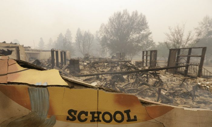 The burned remains of the Paradise Elementary school is seen in Paradise, Calif., on Nov. 9, 2018. (AP Photo/Rich Pedroncelli)