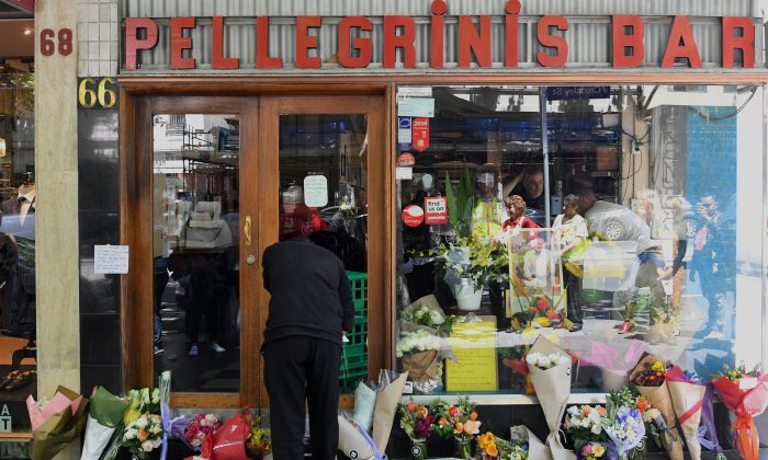 Floral tributes can be seen outside Melbourne's Pellegrini's Cafe for Sisto Malaspina, the day after he was stabbed to death in an attack police have called an act of terrorism, in central Melbourne, Australia, on Nov. 10, 2018.    (AAP/James Ross/via Reuters)