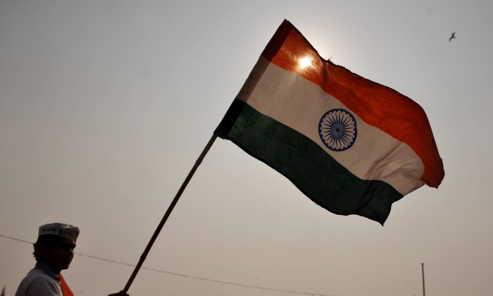 India's national flag held during a rally in Ram Lila Ground in New Delhi on December 27, 2011. (SAJJAD HUSSAIN/AFP/Getty Images)