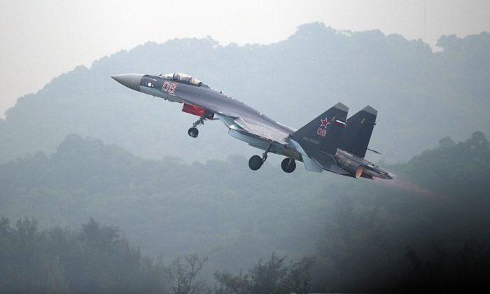 A Sukhoi SU-35 fighter jet takes off during a test flight ahead of the Airshow China 2014 in Zhuhai, a city in southern China's Guangdong Province, on Nov. 10, 2014. (Johannes Eisele/AFP/Getty Images)