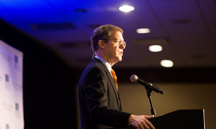 Sam Brownback speaks at the commemoration of the 20th anniversary of the International Religious Freedom Act hosted by the Religious Freedom Institute in Washington on Nov. 9, 2018. (Margaret Wroblewski/RFI)