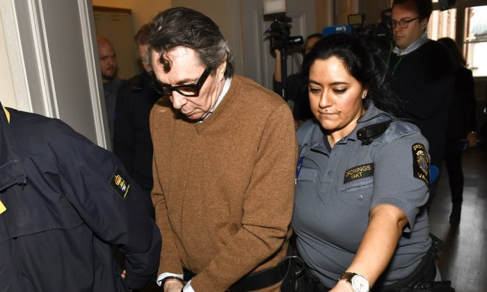 Frenchman Jean-Claude Arnault is escorted from court after the first day of his appeal trial, in Stockholm, on Nov. 12, 2018. (Jonas Ekstromer/TT News Agency via AP)