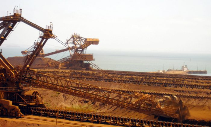 Remote-controlled stackers and reclaimers moving iron ore at Rio Tinto's Port Dampier operations in Western Australia's Pilbara region. (Amy Coopes/AFP/Getty Images)