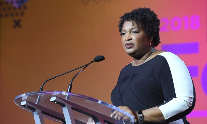 Stacey Abrams speaks onstage during the 2018 Essence Festival presented by Coca-Cola at Ernest N. Morial Convention Center in New Orleans, Louisiana, on July 7, 2018. (Photo by Paras Griffin/Getty Images for Essence)